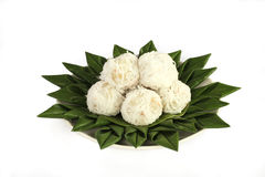 Coconut Balls on banana leaf. Close up coconut balls on green banana leaf Royalty Free Stock Photo