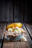Coconut balls in golden box Stock Photos