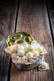 Coconut balls in old blue box Royalty Free Stock Image