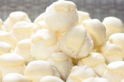 Coconut balls with white chocolate. Handmade coconut balls topped with white chocolate. Shallow DOF royalty free stock photo
