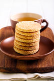 Coconut biscuits and cup of tea Royalty Free Stock Image