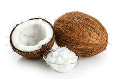 Coconut and bowl with coconut oil. Isolated on white background royalty free stock photography