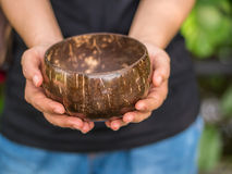 Coconut bowl on hand Stock Photography