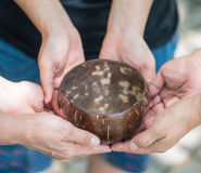 Coconut bowl on hands Stock Image