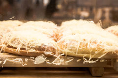 Coconut bread on wooden board at display bakery shop Stock Photography