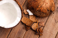 Coconut, broken and open ready for eating Royalty Free Stock Photos