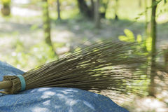 Coconut broom stick lay down of blue sheet. Royalty Free Stock Image