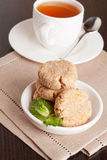 Coconut butter cookies with cup of tea. Vertical, close up Stock Image
