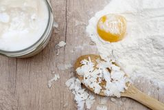 Coconut butter, flour and egg stock photography