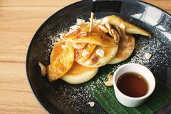 Coconut butter pancake. And banana with honey syrup Stock Photo