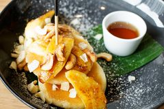 Coconut butter pancake. And banana with honey syrup Royalty Free Stock Photos