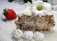 Coconut cake. A coconut cake with whipped cream and strawberry Royalty Free Stock Images