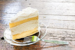 Coconut cake. A piece of coconut cake with a fork Stock Images
