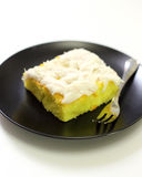 Coconut cake in black plate Royalty Free Stock Photo