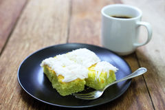 Coconut cake with coffee on wood Stock Images