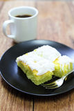 Coconut cake with coffee on wood Royalty Free Stock Photos