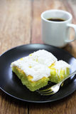 Coconut cake with coffee on wood Stock Image