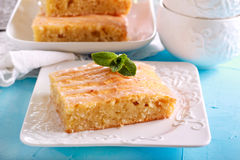 Coconut cake with icing, sliced. On plate Royalty Free Stock Photo