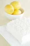 Coconut cake and lemons Royalty Free Stock Photos