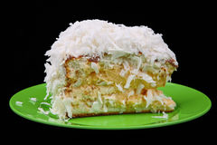 Coconut cake piece on green plate Royalty Free Stock Images