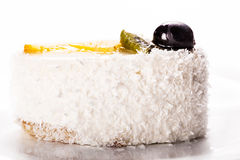Coconut cake slice close-up Royalty Free Stock Photography