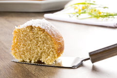 Coconut cake with slice on the table Royalty Free Stock Images