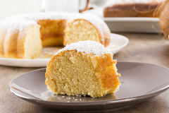 Coconut cake with slice on the table Royalty Free Stock Photo