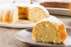 Coconut cake with slice on the table Stock Photo