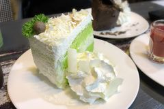 Coconut cake white choc cheese green tea.  royalty free stock image