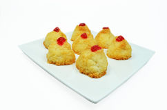 Coconut cakes with cherries Stock Images