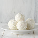 Coconut candies pile in white plate Stock Photos