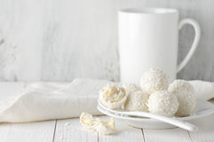 Coconut candies pile in white plate and cup Stock Image