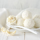 Coconut candies pile in white plate Stock Images