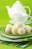 Coconut candies and tea Royalty Free Stock Image