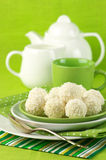 Coconut candies and tea Stock Image