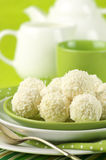 Coconut candies and tea Stock Photos