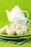 Coconut candies and tea Royalty Free Stock Photo