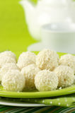 Coconut candies and tea Stock Photography
