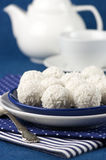 Coconut candies and tea Stock Images