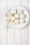 Coconut candies on white wood Royalty Free Stock Photography
