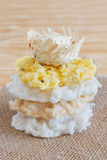Coconut candy cocada with wicker hat on sackcloth Stock Photos