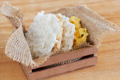 Coconut candy cocada in wooden box with sackcloth Stock Photos
