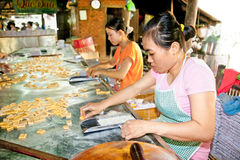 Coconut candy manufacture in Que Dua at Ben Tre  , Vietnam . Stock Photos