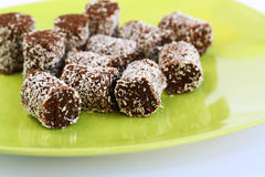Coconut and chocolate candies stock photography