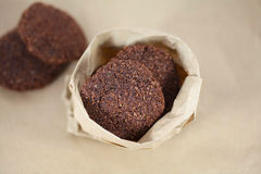Coconut chocolate cookies in brown paper bag Royalty Free Stock Image