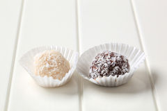Coconut-coated chocolate balls Stock Images
