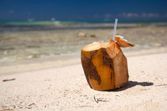 Coconut cocktail on beach on caribbean sea Stock Photo