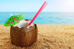 Coconut cocktail at the beach. Close-up Stock Image