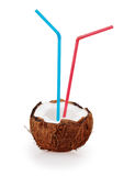 Coconut cocktail with blue and red straws Stock Photography