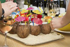 Coconut cocktail with colorful straws and colored paper  palm tr Stock Images